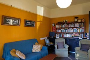 Guest lounge and library at Chester St Backpackers